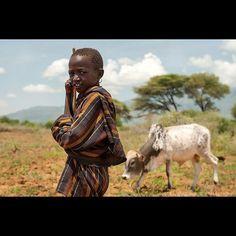 Karamojong child looking after the cattles in a village outside Moroto, Karamojo. #africa #portrait #travel #world #uganda #instatravel #face #retrato #wanderlust #reise #color #africanlife #traditions #customs #vagabond #viajar #sky #imagine #go #experience #discover #openyourmind #vghelg #verden #reallife #story #people #tribe #customs #traditions