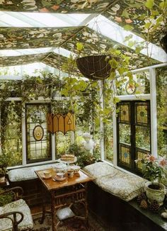 The ultimate reading spot for bookworms and plant lovers: a converted greenhouse! This space also makes a romantic setting for a tea party.
