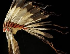 Native American Headdress Symbolism. Each feather represented an act of bravery or charity to the group. Each was earned and authorized by the tribe.