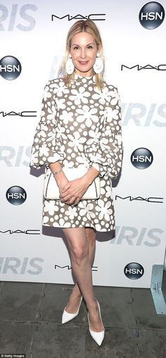 Glamming in style: Kelly Rutherford, 46, dons a chic retro dress to the Iris Film Premier ...