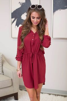Beautiful, casual hot pink dress with tie waist! This number has a V-neck with gold button detail & roll tab sleeves. Wear with or without leggings.
