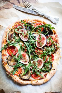 Fig, tomato, arugula, and eggplant pizza