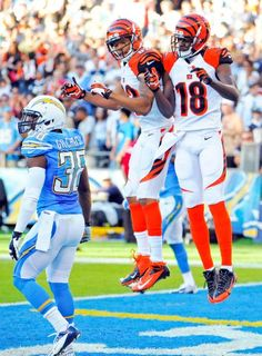 Cincinnati Bengals wide receiver A.J. Green (18) celebrates his touchdown with teammate wide receiver Marvin Jones as San Diego Chargers strong safety Marcus Gilchrist stands by at left. The Bengals won 17-10. (Denis Poroy/AP)