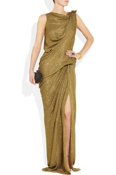 Draped and gathered at the waist and bodice, Lanvin's lamé gown has the appearance of liquid gold.