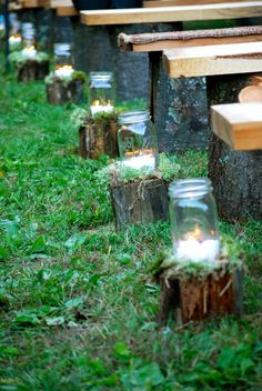 you could put little stumps with candles like this leading up to the arch in the church. that'd be super cute!