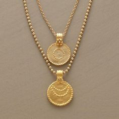Charms of 24kt gold vermeil hand brushed to a matte finish represent the sun and moon. The necklace suspends one from each of two vermeil chains, one a ball chain, the other links