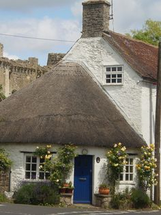 The village of Nunney, in the Mendip district of Somerset, England. The village has an old castle, ducks walking around in the streets, and this cottage with THOSE FLOWERS and THAT BLUE DOOR. (IanGMclean on flickr)