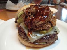 Take a look inside the Cheddar's Test Kitchen.  Our half-pound burger topped with pulled pork.