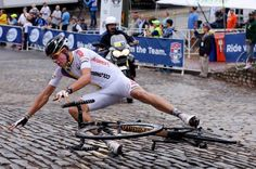 Julian Cardona goes over on the cobbles during the junior race at worlds
