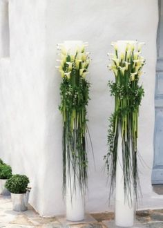 While these aren't centerpieces, they are interestingly tall arrangements!  Tons of calla lilies, bear grass and italian ruscus.