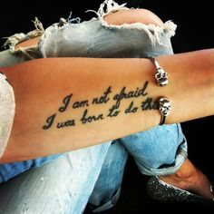 """I am not afraid, I was Born to do this.""  Arm tattoo."