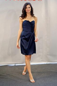 Your bridesmaids will thank you for this strapless navy Watters cocktail dress with floral details.