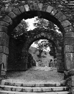 Entrance to St Kevin's monastery in Glendalough - Ireland. If u look to the bottom left of frame, u might be able to see a metal hand rail. I imagine St Kevin could have found such a railing useful.