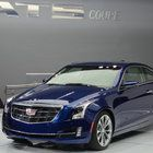 The second day of the 2014 North American International Auto Show was full of luxury and horsepower.While the vehicles themselves were at the center of Tuesday's news, they weren't the only ones making headlines.