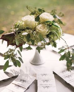 The bride ordered her escort cards on Minted.com and displayed them around an arrangement of 'Vendela' roses, seeded eucalyptus, ivy, and hydrangeas.