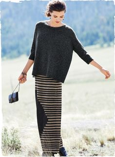 Balance a voluminous top with our long column skirt. Fine gauge knit in irregular stripes of undyed taupe and charcoal; an off-center diamond adds modern edge.