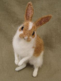 This is more than craft. This is art. Rabbit with caramel colored spots needle felted by Ainigmati, $181.00