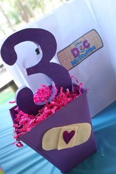 Cute decorations for a Doc McStuffins 3rd birthday party
