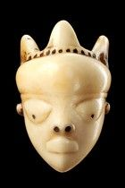 D. R. Congo, Pende  ivory, shiny patina, of oval form, eyes with drilled pupils, tattoos on the forehead, holes for attachment, min. dam., n...