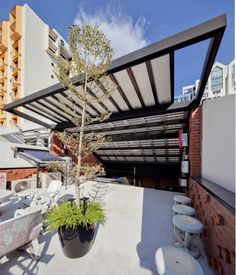 Gallery of 36 BTrd / DP Architects - 13 Though historic throughout principle, your pergola Shed Roof, House Roof, Dp Architects, Pergola Decorations, Shade House, Fibreglass Roof, Steel Pergola, House In Nature, Pergola Plans
