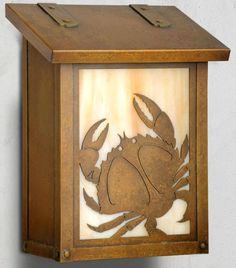 America's Finest Lighting Company Coastal Cottage Wall Mounted Mailbox Finish: New Verde, Glass Color: Gold Iridescent