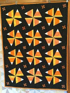 'love this candy corn Halloween pinwheel quilt. Three strips are joined & cut into triangles to form triangle-in-a-square block with black background. HSTs make up cornerstone pinwheels in the black sashing. Halloween Quilts, Halloween Quilt Patterns, Halloween Blocks, Halloween Sewing Projects, Halloween Design, Halloween Candy, Cute Quilts, Mini Quilts, Quilt Block Patterns