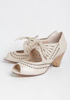 e5a01952209b These chic beige faux leather pumps are designed with intricate laser cut  detailing and a cutout