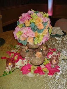 peach roses, pink peony, green sweet peas, and blue hydrangea fish bowl wedding centerpiece