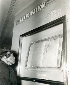 This remarkable photograph shows the then oldest living ex-slave, Mrs. Sally Fickland, viewing the Emancipation Proclamation in the Freedom Train at Philadelphia, on September 17, 1947