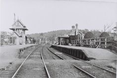Teralba Railway Station, NSW. c.1910. Signal station on left. Facing southbound, before pedestrian overbridge was built. Footrack visible over rails.