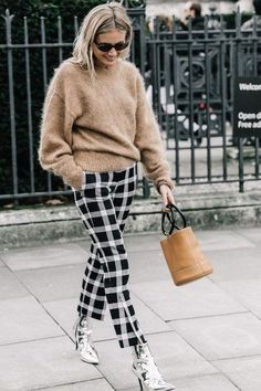 Loving this brown sweater paired with gingham pants and silver shiny boots!