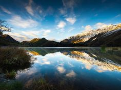 Stunning Moke Lake Sunrise wall mural from Wallsauce. This high quality Moke Lake Sunrise wallpaper is custom made to your dimensions. Easy to order and install plus FREE UK delivery within 2 to 4 working days. Sunrise Wallpaper, Lake Wakatipu, Sunrise Lake, Visit New Zealand, South Pacific, Photo Wallpaper, Wall Murals, Places To Visit, Scenery