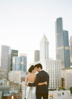 A cityscape can make for the perfect wedding photo backdrop!