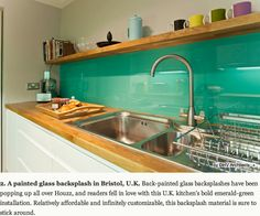 A painted glass backsplash in Bristol, U.K.  Relatively affordable and infinitely customisable.