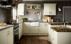 Want to recreate a warm and welcoming country kitchen? Design your country kitchen with these expert tips and tricks Kitchen Design Small, Kitchen Cabinets And Backsplash, Ivory Kitchen Cabinets, Ivory Kitchen, Freestanding Kitchen, Benchmarx Kitchen, Country Kitchen Designs, Home Kitchens, Kitchen Design