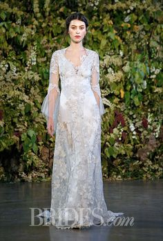 """Brides.com: . """"Michaela"""" antique tulle and Guipure lace sheath wedding dress with a v-neckline, long sleeves, and gold and silver floral embroidered details, Claire Pettibone"""