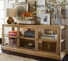 Lindley Glass Media Console | Pottery Barn. Option for new Media Unit. Tv wall mounted above.