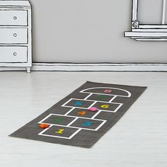 You don't have to wander far to find a uniquely designed hopscotch playmat. Our Hop, Skip and a Jump Playmat is available right here. It even includes two beanbags for even more games to play.