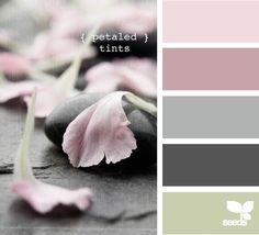 Light grey walls Dark grey carpet Pale pink curtains & throws