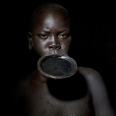 Surma woman with lip plate - Ethiopia | © Eric Lafforgue