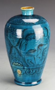 China, Yuan Dynasty., blue glazed Meiping vase, with dark painted floral designs, with loosely rendered birds and auspicious symbols. Height 18 in