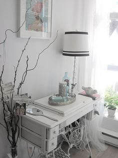 Old treadle sewing machine in white - love this!