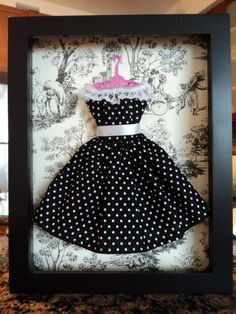 Put barbie clothes in shadow boxes for decor. CUTE girls' room idea!