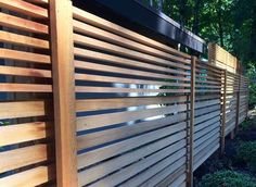 Fence & Screen Experts Horizontal Fence & Screen Experts PANELS TEAK Because more and more of our designs are about extending the inside into the yard, we want to design our fences to read more like walls. This allows us to create a visually pleas Bamboo Screening, Fence Screening, West Linn Oregon, Horizontal Slat Fence, Cedar Fence, Fence Landscaping, Garden Fencing, Back Gardens, Amazing Gardens