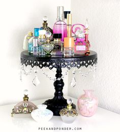 22 Chic ways to decorate with cake stands! Some really cute and gorgeous ideas!!! (this is the Perfume arrangement #19 )