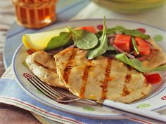Grilled Chicken Paillard with Lemon and Black Pepper and Arugula-Tomato Salad by Bobby Flay