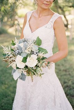 Chelsey's cool bouquet of silver and white... silver brunia, succulents, dusty miller, white roses, blushing bride, and astilbe.