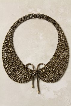 coy bow unites the chainmail-like hemispheres of this collar-hugging bib, adding a femme touch to its edgy glamour. By Dannijo.