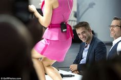 This looks promising: Robert Pattinson looks pleased as he and fellow actor Guy Pearce take in Kylie Minogue's performance on Le Grand Journal i in Cannes on Tuesday
