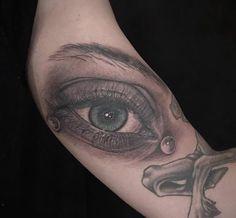 Eye portrait tattoo by Christina Ramos at Memoir Tattoo